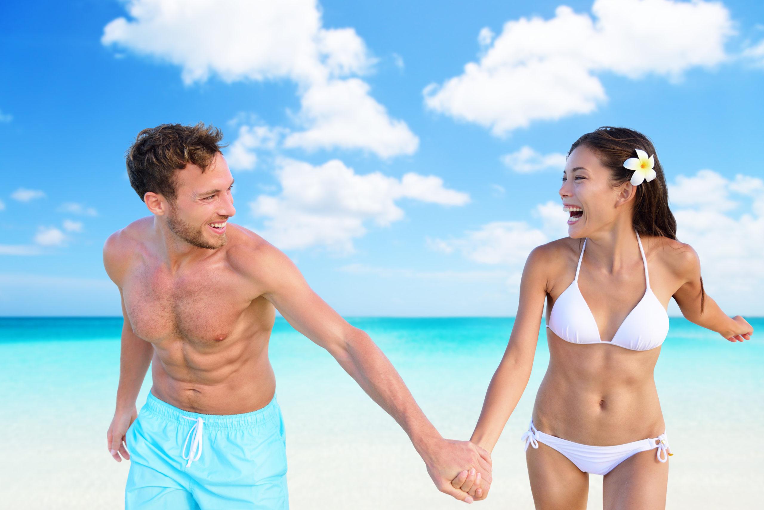 Beach,Vacation,Fun,Sexy,Couple,In,Bikini,Swimwear,And,Blue